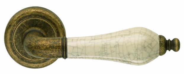 Фото Производитель  Ручка дверная Monica античная отделка/бежевый потрескавшийся фарфор